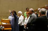 "<p><span style=""font-size: 1em; background-color: transparent;"">People opposing zoning changes near Preston Center, led by architect Carla Percival-Young, stood Thursday during a zoning meeting at Dallas City Hall. The City Plan Commission did not vote on the divisive case that's at the center of a high-profile council race between incumbent Jennifer Staubach Gates and her challenger, former Mayor Laura Miller.</span></p>(Vernon Bryant/Staff Photographer)"