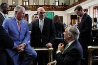 Rep. Dan Huberty (left), R-Humble, chats with Speaker Dennis Bonnen and Gov. Greg Abbott (right) before the House debated and passed a school finance overhaul bill that would pour $9 billion into the state's public education system.(Clarice Silber/The Associated Press)