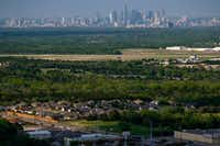 The downtown skyline is seen over Dallas Executive Airport and homes in the Red  Bird area on Thursday, April 4, 2019, in Dallas. (Smiley N. Pool/Staff Photographer)