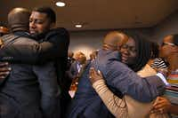 The parents of Jordan Edwards, Odell and Charmaine Edwards (facing camera), hug prosecutor George Lewis (left) and family member Reggie Edwards (right) as they react to a guilty verdict during the trial of fired Balch Springs police Officer Roy Oliver.(Rose Baca/Staff Photographer)
