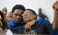 Allison Jean raises her hands in the air as she leans on her son, Brandt, 15, during a prayer service for her son and Brandt's brother, Botham Shem Jean, at the Dallas West Church of Christ on Sept. 9, 2018.(Shaban Athuman/Staff Photographer)