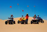 Oklahoma's Little Sahara State Park may be your best bet for a weekend dune getaway from Dallas-Fort Worth. Each vehicle must have a flag above it to help with visibility, since some of the dunes are more than three stories high.(Lisha Newman/Oklahoma Tourism)