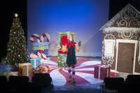 Garret Storms performs in performs in an adaptation of David Sedaris's <i>Santaland Diaries</i> at the WaterTower Theatre on Dec. 4, 2014(Rex C. Curry/Special Contributor)
