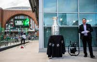 Stanley Cup keeper Howie Borrow stands with the Stanley Cup outside American Airlines Center before Game 6 of the first round of the Stanley Cup playoffs between the Dallas Stars and the Nashville Predators.(Ashley Landis/Staff Photographer)