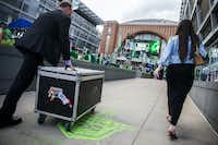Stanley Cup keeper Howie Borrow (left) and Lauren Montgomery (right) of Allied Global Marketing wheel a box containing the Stanley Cup to a location outside American Airlines Center before Game 6 of the first round of the Stanley Cup playoffs between the Dallas Stars and the Nashville Predators.(Ashley Landis/Staff Photographer)