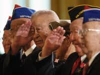 Members of the famed 442nd Regimental Combat Team of the United States Army, a unit composed of mostly Japanese Americans who fought in Europe salute President Bush, Thursday, May 1, 2008, in the East Room of the White House in Washington, during a ceremony celebrating Asian Pacific American Heritage Month. (Ron Edmonds/ASSOCIATED PRESS)