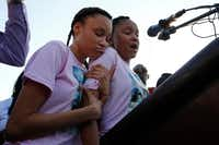 Shavon Randle's sisters Kayla Randle, 14, (right) and Shiniece Richards, 16, spoke during a vigil for their sister, who was killed and left in an abandoned home in Dallas in 2017.(Nathan Hunsinger/Staff Photographer)