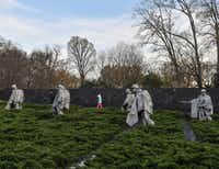 The Korean War Veterans Memorial features statues of 19 poncho-wearing soldiers on patrol.(Ricky Carioti/The Washington Post)