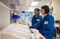 Vertex Pharmaceuticals scientists work at its lab in San Diego.(Vertex Pharmaceuticals)