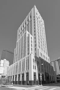 Lang & Witchell designed multiple skyscrapers in Dallas and commercial properties in Fort Worth and across the state. The Dallas Power & Light Building, completed in 1930 on Commerce Street downtown, is one of the best. Photograph by Jim Parsons. From T<i>he Open-Ended City: David Dillon on Texas Architecture,</i>edited by Kathryn E. Holliday, foreword by Robert Decherd, published by the University of Texas Press.(Jim Parsons)