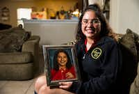 Dreamer Judith Juarez, a senior at Irma L. Rangel Young Women's Leadership School, holds her graduation photo in her home on Tuesday, April 23, 2019, in Dallas. With a DACA permit, Juarez will be able to legally work and Texas law will allow her to pay in-state tuition at a public college.(Ashley Landis/Staff Photographer)