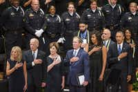 From left, Jill Biden, Vice President  Joe Biden, Laura Bush, former President George W. Bush, Michelle Obama and President Barack Obama stand for the national anthem during an interfaith memorial service at the Morton H. Meyerson Symphony Center in Dallas on Tuesday, July 12, 2016, for five law enforcement officers killed in an ambush at a Black Lives Matter rally. (Smiley N. Pool/Staff Photographer)