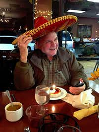 Robert Compton, better known as Bob Compton, former books editor for <i>The Dallas Morning News</i>, having a light moment during his 91st birthday party at a local restaurant in recent years.(Christie Grothe)