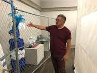 """<p>El Paso historian David Romo is co-curator of the """"Uncaged Art"""" exhibition, which opened at UTEP's Centennial Museum. He shows off a traditional dress made by&nbsp;Central American migrant youths whose work is on display in the """"Uncaged Art"""" exhibition at UTEP's Centennial Museum.</p>(Alfredo Corchado/Staff)"""