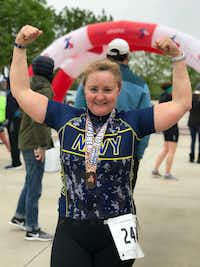 Emily Susan Law, 49, celebrates after a triathlon in April 2018.(Courtesy/Kae Law)