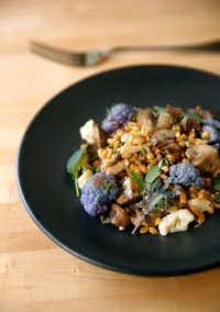 Sachet co-owner and chef Stephen Rogers prepared a Farro Salad with Mushrooms at his Oak Lawn Avenue restaurant in Dallas.(Tom Fox/Staff Photographer)