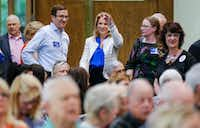 Jennifer Staubach Gates, center, councilwoman for City Council District 13, greets voters before a debate with Laura Miller at Jesuit College Preparatory School of Dallas, Monday, April 22, 2019.(Brandon Wade/Special Contributor)