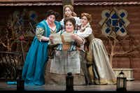 Stephanie Blythe (seated) as Mistress Quickly, with (from left) Angela Meade as Alice Ford, Mojca Erdmann as Nannetta, and Megan Marino as Meg Page perform in the dress rehearsal of the Dallas Opera's <i>Falstaff </i>at the Winspear Opera House.(Allison Slomowitz/Special Contributor)