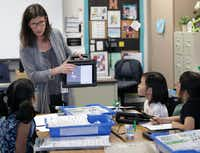 Teacher Kim Madden with students Friday at Isbell Elementary School in Frisco.(Jason Janik/Special Contributor)