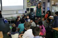Kelsey Newman with a fourth-grade class Friday at Isbell Elementary School.(Jason Janik/Special Contributor)