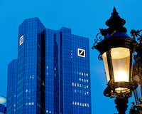 Deutsche Bank headquarters is seen behind a lamp in Frankfurt, Germany. President Donald Trump has gone to court to fight an attempt by the House to obtain his business records.(Michael Probst/AP)