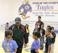 Pastor Rickie G. Rush of Inspiring Body of Christ Church talks with University of Dreams summer students in the church's gymnasium.(Special Contributor/Milton Hinnant)