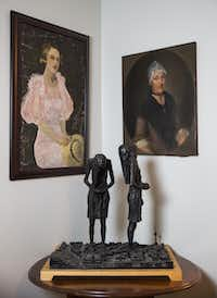 Painted portraits and a sculpture are displayed in the Austin home of authors Elizabeth McCracken and Edward Carey.(Ashley Landis/Staff Photographer)