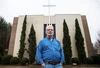 "John Smid, the former director of Memphis-based ex-gay ministry Love In Action, poses for a photograph in front of his church in Paris, Texas on Dec. 7, 2018. A character is based off him in the new movie ""Boy Erased,"" which came out in November. (Carly Geraci/Staff Photographer)"