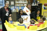 University of Dreams administrators Shunta Hunter (far left) and Sherrye Vaden (far right), who are administrators of Inspiring Body of Christ's school, the University of Dreams, visited a class of infants and their teacher in September.(Milton Hinnant/Milton Hinnant/Special Contribut)