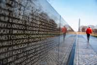 The Vietnam Veterans Memorial is inscribed with the names of more than 50,000 Americans killed in the war.(Calla Kessler/The Washington Post)