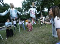 Ryan Matthieu Smith, right, directs the cast of <i>The Bacchae</i> in a rehearsal at Kidd Springs Park, including giant puppets representing two elders of Thebes.(Jason Janik/Special Contributor)