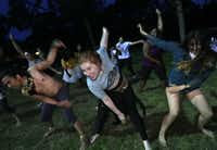 The cast of Giant Entertainment's <i>The Bacchae</i> rehearse a dance sequence at Kidd Springs Park.(Jason Janik/Special Contributor)