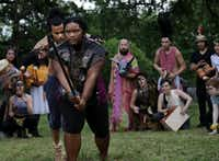 """<p><span style=""""font-size: 1em; background-color: transparent;"""">Raymond Govender (left), Dencia Baltimore and other cast members of Giant Entertainment's City Dionysia festival rehearse at Kidd Springs Park. The three-day festival at Annette Strauss Square includes a production of the ancient Greek play </span><em style=""""font-size: 1em;"""">The Bacchae</em></p>(Jason Janik/Special Contributor)"""