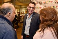 Dallas City Council candidate for District 1, Giovanni Valderas, centers, speaks with Jesse Taffalla Jr., and Sylvia Lagos during an event hosted by Hispanic organizations to meet elected officials in Dallas, Friday evening, Jan. 4, 2019 at Mercado369. (Ben Torres/Special Contributor)