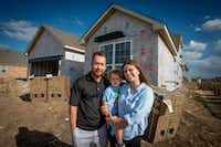 The Brace family, James, Lucas (center) and Samantha, stand outside their new home in Fort Worth.(Robert W. Hart/Special Contributor)