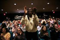 Mary Ukiri, a junior at Lake Highlands High School, cheers for her classmate as he performs during a Hamilton Education Program event at the Music Hall at Fair Park in Dallas on May 2, 2019.(Rose Baca/Staff Photographer)