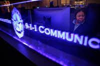 Kesha Williams, a 911 call taker, works in the Dallas Police 911 call center at Dallas City Hall.(Rose Baca/Staff Photographer)