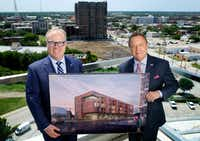 Jim Hinton, CEO of Baylor Scott & White Health (left) and Jeff Fehlis, executive vice president of the American Cancer Society South Region, hold a rendering of the Gene and Jerry Jones Family Hope Lodge.(Tom Fox/Staff Photographer)