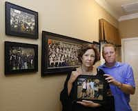<p>Lisa and Dave Stephenson hold a photograph of them with Thomas Johnson, whom they took into their home in Farmersville.</p>(David Woo/Staff Photographer)