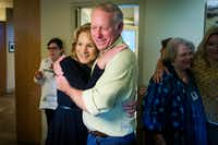 Dallas City Council member Jennifer Staubach Gates hugs husband John Gates as early voting results showing her with a lead on challenger Laura Miller were posted during an election night watch party on Saturday, May 4, 2019.(Smiley N. Pool/Staff Photographer)