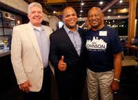 Dallas mayoral candidate and current State Representative Eric Johnson (center) poses for a photo with his Greenhill School football coach Tom Perryman (left) and Dallas Cowboys great Mel Renfro during an election night party at Smoky Rose restaurant Saturday night in Dallas. (Staff Photographer/Tom Fox)