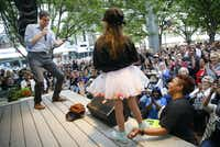 Democratic Presidential candidate Beto O'Rourke responds to a question from a young girl during a Q&A session following his speech to hundreds of supporters outside The Flying Saucer in downtown Fort Worth, Friday, May 3, 2019.  O'Rourke made his first appearance in North Texas since launching his presidential campaign.(Tom Fox/Staff Photographer)