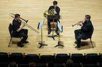 From left: Barry Hearn (trombone), Kevin Haseltine (horn) and Russell Campbell (trumpet) perform the 1922 Sonata for horn, trumpet and trombone by Francis Poulenc.(Smiley N. Pool/Staff Photographer)