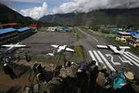 The airport in Lukla has long been considered one of the most dangerous in the world, with a runway of a mere 1,700 feet in length — vs. the typical 6,000 to 8,000 feet. The runway slopes upward to help arriving planes slow down and avoid hitting a solid rock wall.  (The Associated Press/2013 File Photo)