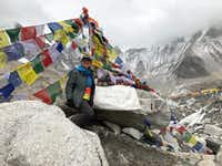 Writer Molly Sprayregen beams after reaching Everest Base Camp, which rests on a massive glacier at 17,600 feet in elevation. The hike took eight days.(James Sprayregen/The Associated Press)