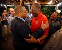 <p>Dallas mayoral candidate and state Rep. Eric Johnson (left) is congratulated by state Sen. Royce West of Dallas during an election night party at Smoky Rose restaurant on May 4, 2019.</p>(Tom Fox/Staff Photographer)