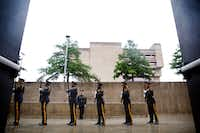 The Dallas Police Honor Guard performs a 21-gun salute during the Dallas Police memorial service, honoring officers who lost their lives in the line of duty.(Rose Baca/Staff Photographer)
