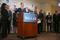 At a Jan. 9 news conference, VisitDallas President and CEO Phillip Jones -- surrounded by executives, board member  and supporters -- defended himself and  VisitDallas.(Ryan Michalesko/Staff Photographer)