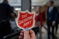 A supporter of the Salvation Army's proposed 20-acre campus along an industrial corridor of Stemmons Freeway handed out stickers before Wednesday's meeting.(Smiley N. Pool/Staff Photographer)