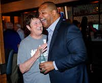 Dallas mayoral candidate and current state Rep. Eric Johnson is congratulated by his elementary and middle school teacher Elaine Velvin during an election night party at Smoky Rose restaurant.(Tom Fox/Staff Photographer)